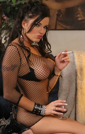 Big boobed porn star babe Lanny Barbie drinking and smoking a cigarette in a ...